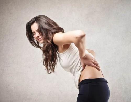 Женщина и боль в спине